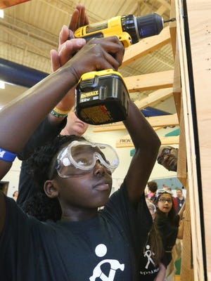 Fifth grader Amy Luwaja uses a drill to puts up the side of the house during the If I Had a Hammer: TheHammer BuildExperience program at Hobgood Elementary Thursday, Feb. 23, 2017.