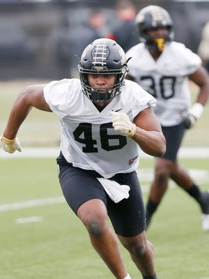 Sophomore linebacker Cornel Jones runs a drill during Purdue spring football practice Wednesday, February 28, at the Bimel Practice Complex.