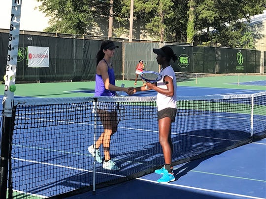 Loyola's Tiffani Nash (right) was forced to retire in the first set of her Girls 18 championship match at the Walk-On's Independence Bowl Junior Tennis Classic on Monday.