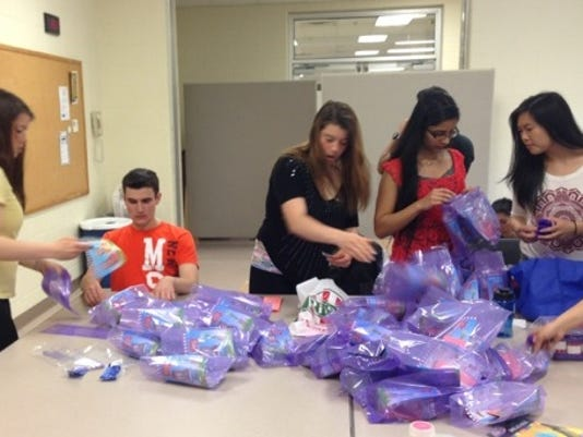 Courier News Purple Laces Walk Goody Bags 1.jpg