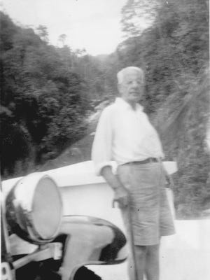 Dr. A. J. Chandler relaxing during his 1938 trip around the world.