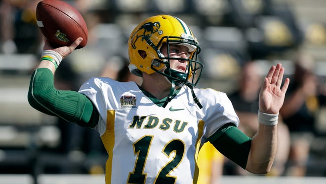 North Dakota State quarterback Easton Stick warms up before an NCAA college football game against Iowa, Saturday, Sept. 17, 2016, in Iowa City, Iowa. (AP Photo/Charlie Neibergall)