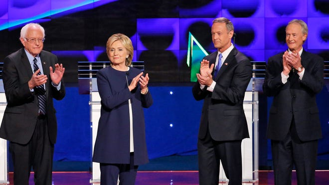 Democratic presidential candidates from left, Sen. Bernie Sanders, of Vermont, Hillary Rodham Clinton, former Maryland Gov. Martin O'Malley, and former Rhode Island Gov. Lincoln Chafee take the stage before the CNN Democratic presidential debate Tuesday, Oct. 13, 2015, in Las Vegas.