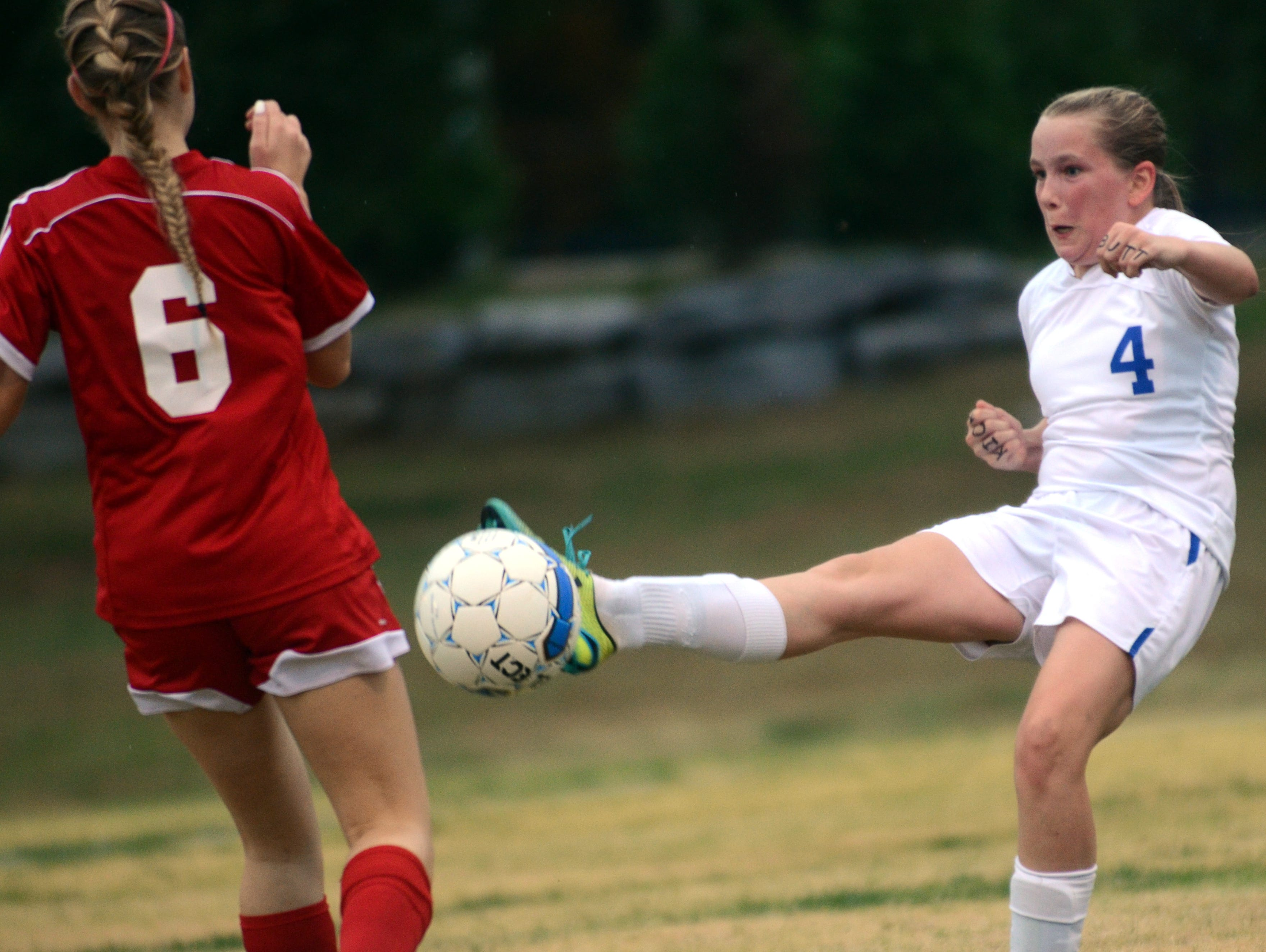 White House High freshman defender Haley Moran clears a ball upfield during first-half action in front of Page senior Marisa Mancini.