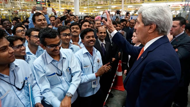 Secretary of State John Kerry talks to workers at a soon-to-be opened Ford India automotive factory in Sanand, India, on Jan. 12.