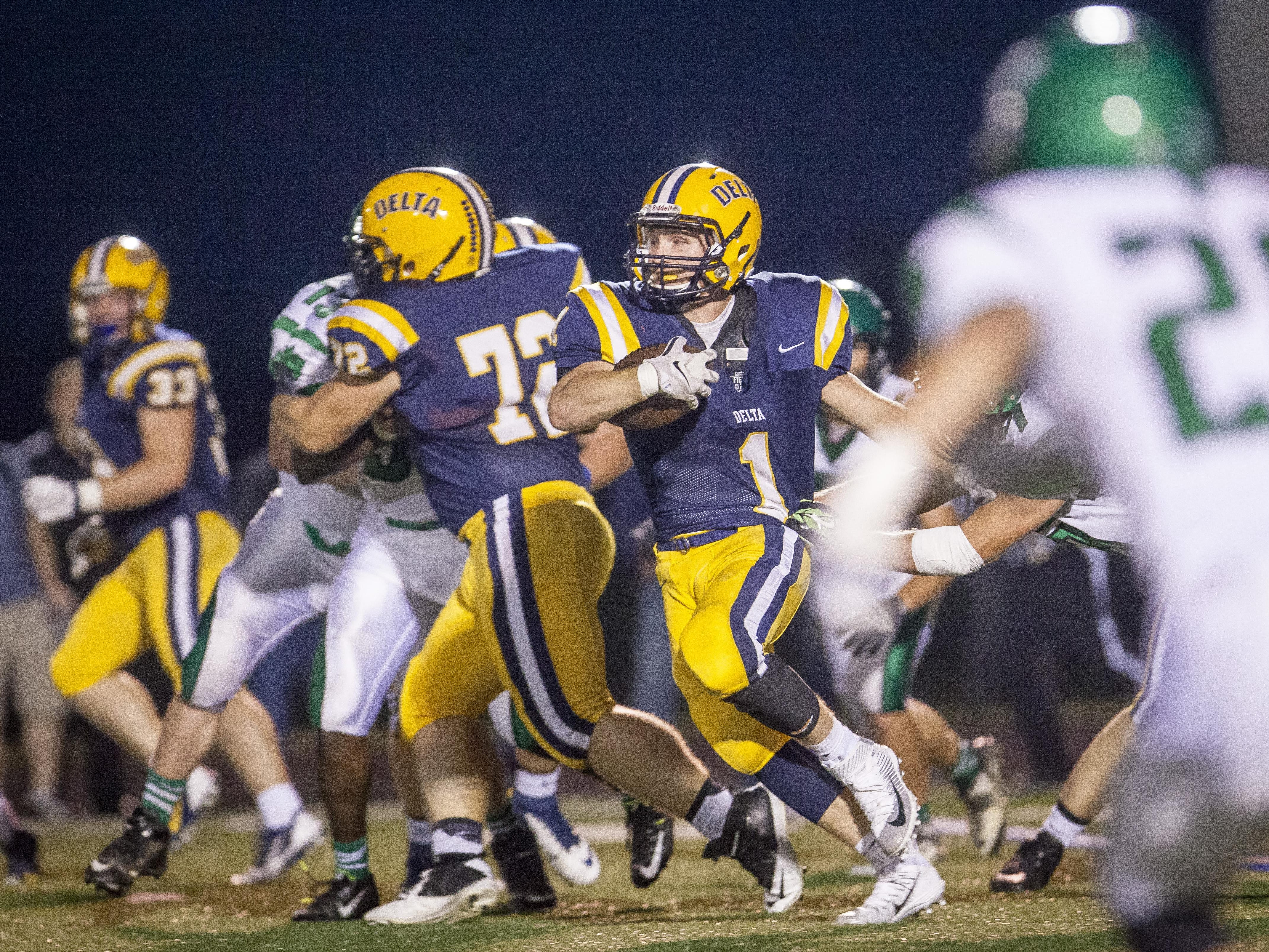 Delta's Zach Mills breaks through the line during a run Friday evening during the home game at Delta High School.