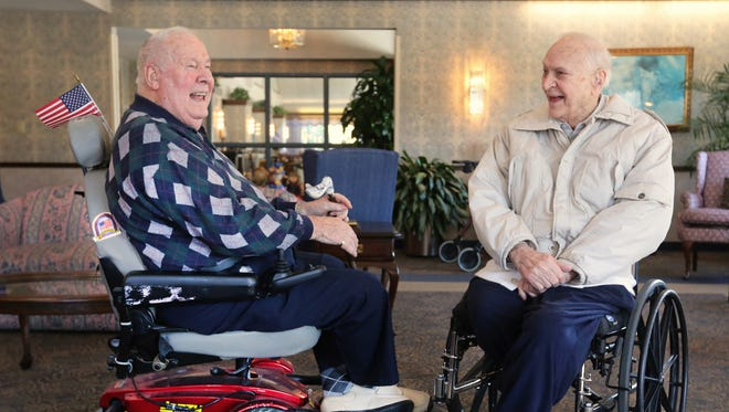 Paul Ruberg, left, and Roy Romes, both 90, meet for the first time in 71 years at Ruberg's home in the Western Hills Retirement Village. Romes lives in Fort Wright. They graduated from Elder High School in 1943 and joined the Navy together. They lost touch after World War II.