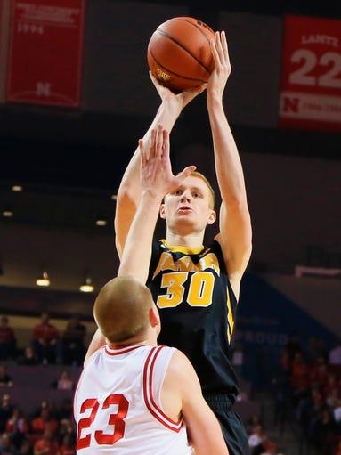 Iowa's Aaron White (30) shoots over Nebraska's Nick