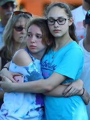People wait for the start of a vigil May 18, 2018,