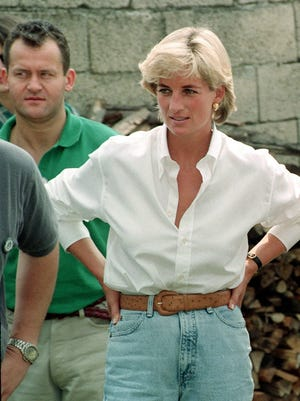 Diana, Princess of Wales, and her butler, Paul Burrell, rear left, met Bosnian Serbs and Muslims affected by landmines near Tuzla, Bosnia in 1997.  {ASSOCIATED PRESS FILE]