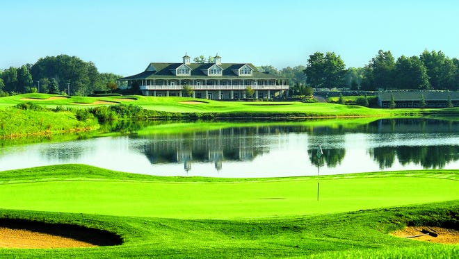 The 17th and 18th greens and clubhouse at Hawk Hollow.