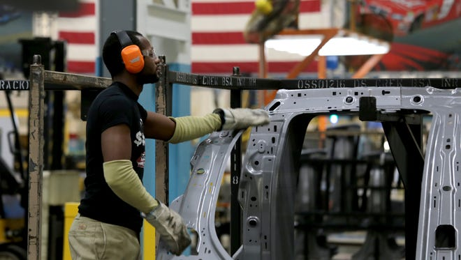 James Dosier, 26, of Detroit moves a side panel for a Dodge Durango from one of 3 new presses as part of a $166 million investment to bring the latest state-of-the-art stamping technology to the FCA US Sterling Heights Stamping Plant in Sterling Heights on Friday, August 26, 2016.Jessica J. Trevino