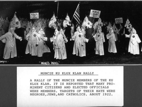 """This photo from around 1922 shows a rally of the Muncie members of the Ku Klux Klan. Information included with the photo notes reports """"that many prominent citizens and elected officials were members. Targets of their hate were African-Americans, Jews and Catholics."""""""