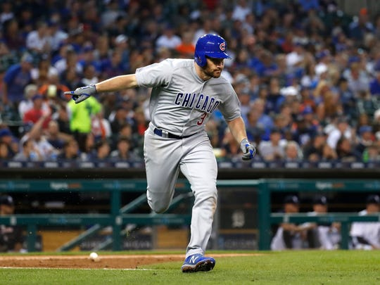 Chicago Cubs' Daniel Murphy gestures after an RBI single in the fifth inning of a baseball game against the Detroit Tigers in Detroit, Wednesday, Aug. 22, 2018. (AP Photo/Paul Sancya)