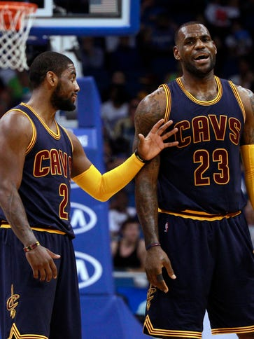 Cleveland Cavaliers guard Kyrie Irving (2) and forward