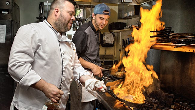 Chefs prep meals at The Gate House of Lewes.