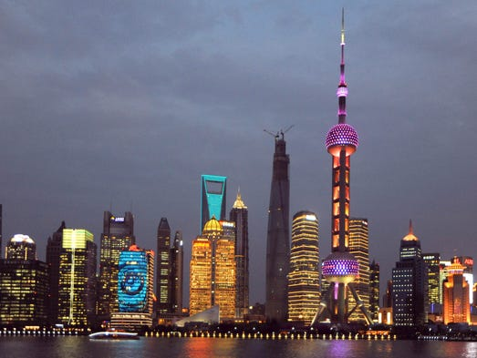 Skyline of Huangpu River and the Lujiazui Financial District with the Oriental Pearl TV Tower, tallest, the Shanghai Tower under construction, second tallest, the Shanghai World Financial Center, third tallest, Jinmao Tower, fourth tallest, and other skyscrapers and high-rise buildings in Pudong,