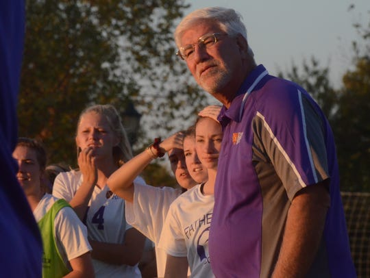 Father Ryan coach Robin Dieterich and the Lady Irish