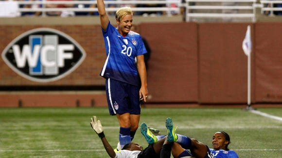 Abby Wambach (20) reacts after Crystal Dunn (25) scores against Haiti during a World Cup Victory Tour game against Haiti at Ford Field in Detroit.