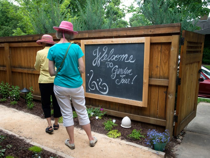 People walk the garden of Kari and Robert Hodgen during the Junior League of Fort Collins' 32nd Annual Terrace and Garden Tour in the City Park neighborhood Saturday, June 21, 2014.