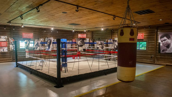 Photographs of legendary boxer Muhammad Ali are displayed around the gym at Fighter's Heaven, Deer Lake, Pa., the former training camp of Ali, on Friday, June 1, 2018. The event was held to commemorate the two-year anniversary of the boxing champ's passing. (David McKeown/Republican-Herald via AP)