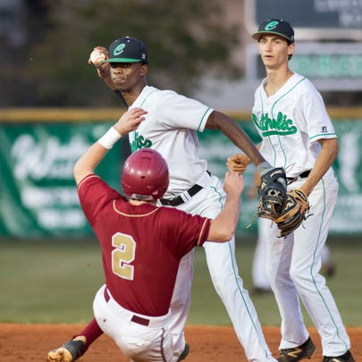 Shortstop TJ Mccants (4) turns an unassisted double