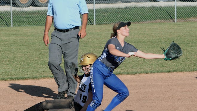 Cairo senior Preslee Brubaker safely steals second base in the bottom of the fourth inning Thursday while Paris shortstop Gracie Wilson awaits the throw from catcher Emma Morgan. The Lady 'Cats won their season home opener 8-1 ove Paris.