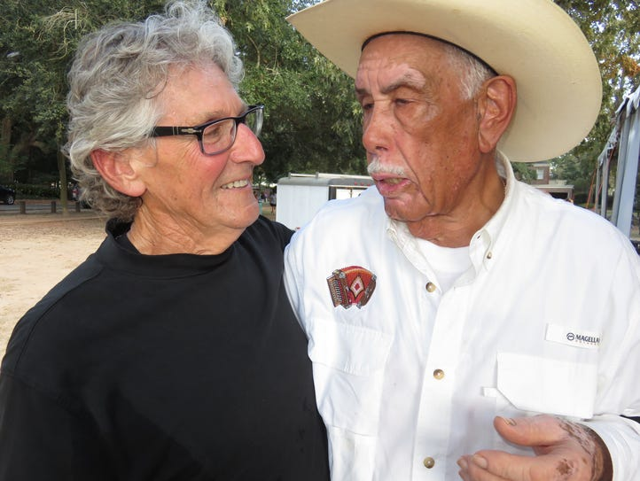 Former state poet laureate Darrell Bourque, left, and