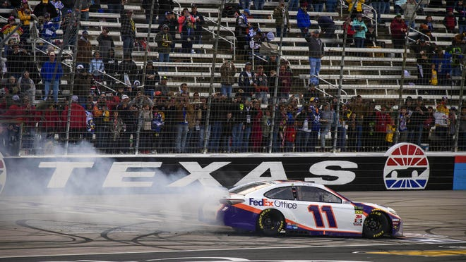 Driver Denny Hamlin performs a burn out after he won NASCAR's O'Reilly Auto Parts 500 at Texas Motor Speedway in March of 2019. The race will return to the racetrack in July after a four-month postponement due to the coronavirus pandemic.