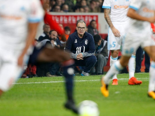 Lille coach Marcelo Bielsa watches the action during their French League one soccer match against Marseille at the Lille Metropole stadium, in Villeneuve d'Ascq, northern France, Sunday, Oct. 29, 2017. (AP Photo/Michel Spingler)