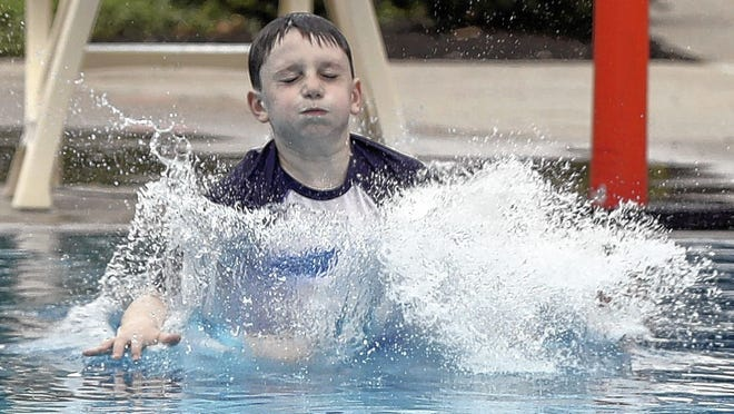 Connor Kreps, 10, of Upper Arlington dives into the water June 16 at the Tremont Pool. The city opened the pool with a modified schedule and safety protocols in response to the COVID-19 coronavirus pandemic. The city also opened Devon Pool, but the Reed Road Water Park will remain closed.