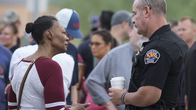 Buckeye assistant police chief Mark Mann (right) talks with Crystal Wilson, the mother of missing 10-year-old Jesse Wilson, July 20, 2016.