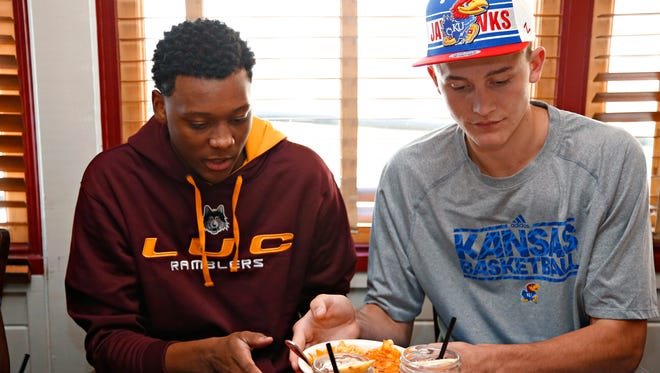 Cameron Satterwhite, who signed with Loyola-Chicago, and Mitch Lightfoot, who signed with Kansas were teammates at Gilbert Christian High School in 2015.