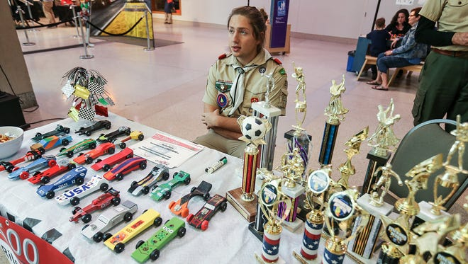 For his Eagle Scout project, Robbie Bruner is collecting Pinewood Derby cars to eventually run a race for Riley Children's Hospital patients using donated cars and trophies, seen on his table during the Indiana State Museum's 10th annual Pinewood Derby, Indianapolis, Saturday, April 1, 2017.