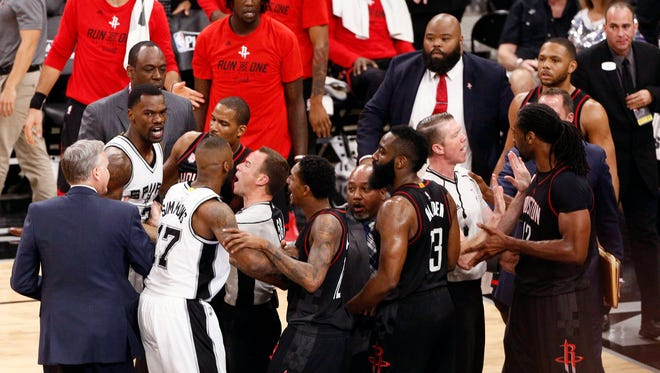 San Antonio Spurs center Dewayne Dedmon (far left) and Houston Rockets center Nene Hilario (far right) are separated by referees during the second half in Game 1 of the second round of the 2017 NBA Playoffs.