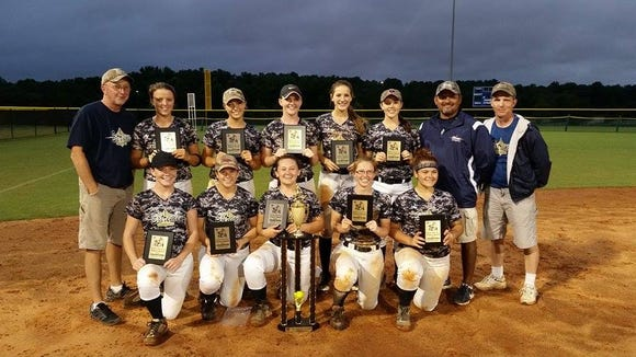 The WNC Extreme Gold softball team.