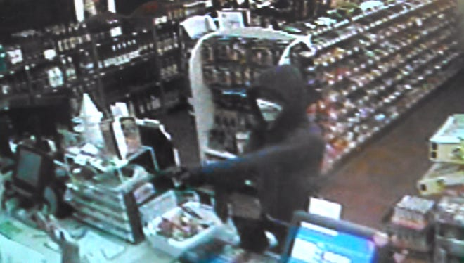 Suspect No. 1 in the Kum & Go robbery on Aug. 4, 2014.