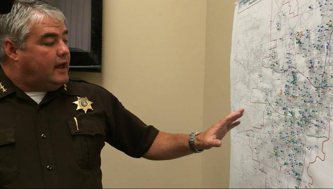 Hinds County Chief Deputy Chris Picou explains a target map of violent areas of Jackson to be used in the BRAVE program.