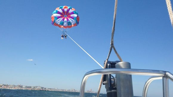 Jen and Marcus Parasailing for 13 weeks of summer