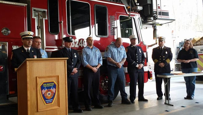 Award recipients are honored on Monday, April 21.   From left, assistant director of Emergency Medical Services David Violante, Arlington firefighters Joseph Moore, Richard McCaffrey, Johel Dongo, Joseph Tarquinio, Lt. George Finn, Chief Tory Gallante and district secretary Renee O'Neill