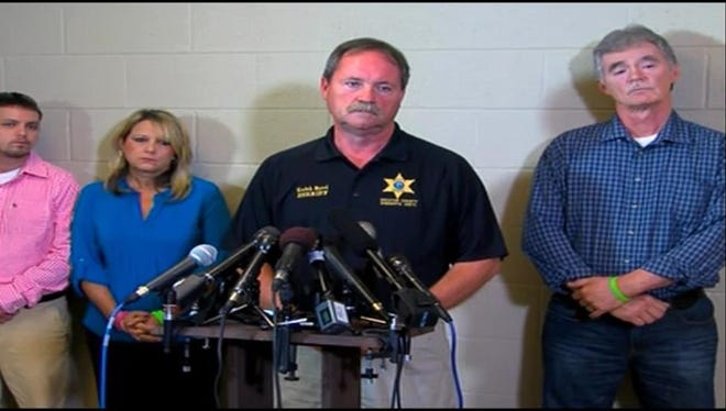 From left to right, Holly Bobo's brother Clint, mother Karen, Sheriff Keith Byrd, and Holly's father Dana Bobo at a news conference this afternoon at the Decatur County Sheriff's Office.