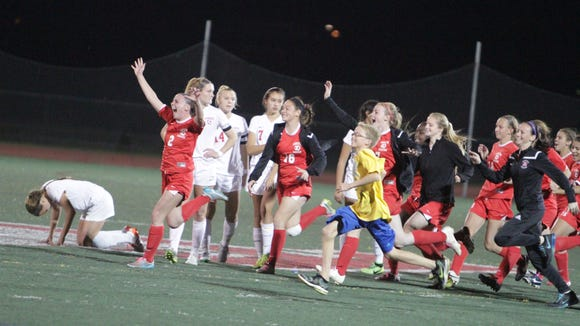 Goshen celebrates after defeating Somers in penalty kicks in the New York State, Class A sub-regional game at Tappan Zee High School on Tuesday, November 3rd, 2015.