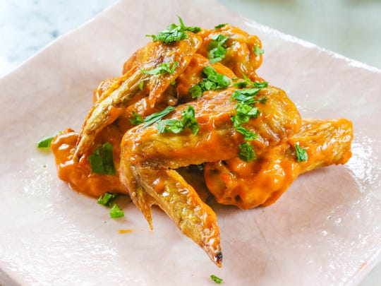 Chicken wings with Thai Curry Peanut Sauce.
