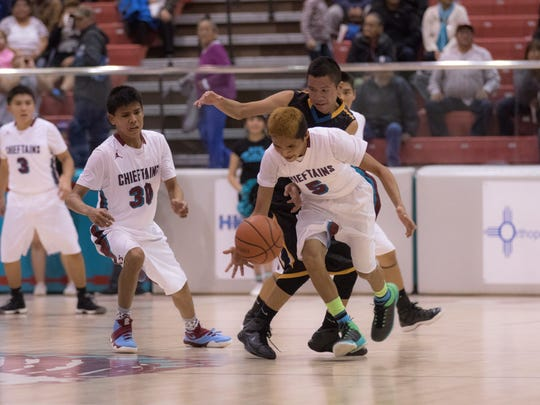 Shiprock's Marlyn Kaskella steals the ball from Navajo Prep's Thomas Montañez III in the final seconds of regulation play on Thursday at the Chieftain Pit in Shiprock.