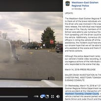 Good Samaritans roll burning car off of trapped driver in police-released video