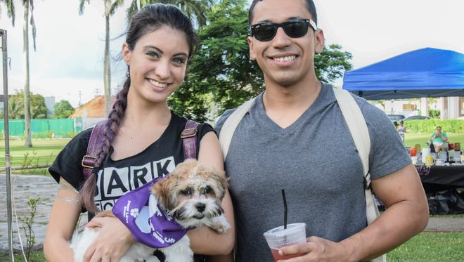 Keana Artero, left, and Brandon Pablo attend the 4th Annual Bark for Life along with four-month-old Shih Tzu, Dimitri Artero, at the Plaza de España on Sept. 5, 2015.