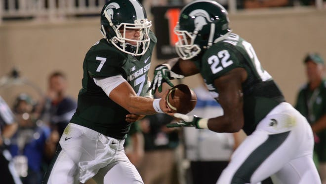 MSU quarterback Tyler O'Connor hands off to Delton Williams Aug. 29 against Jacksonville State. Both should see extended time today against Eastern Michigan.