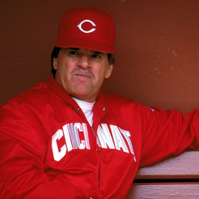 Then-Reds Manager Pete Rose sits in the dugout during