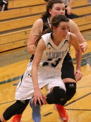 Danbury's Erin Uhinck drives baseline Tuesday against