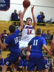 Reno's Tommy Challis (34) shoots over Carson's Trent Robison (12) and Taylor Saarem (11) during their basketball game in Reno on Dec. 23, 2016.